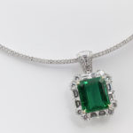 Platinum And Yellow Gold Emerald And Diamond Pendant On A White Gold Diamond Necklace