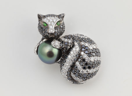 White Gold Cat Brooch with Black and Colorless Diamonds, Tsavorite Garnets, and a Tahitian Pearl