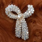 important bow brooch crafted with diamonds